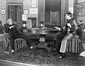 Sherlock Holmes (play) - Holmes (William Gillette, right) gets the drop on Moriarty (George Wessells) in the original Broadway production of Sherlock Holmes (1899)