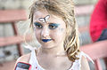 Girl with butterfly facepainting (5407563710).jpg