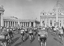 A group of cyclists riding in Rome.