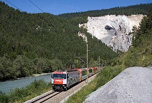 Rhaetian Railway - Two Glacier Expresses coupled together run through the Rhine gorge.