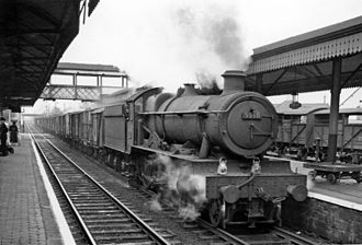 Gobowen railway station - Up fast freight passing in 1960