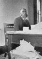 Goodell at desk 1900.png