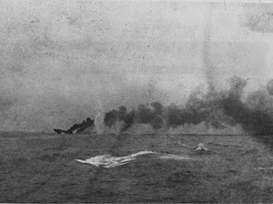 Indefatigable-class battlecruiser - Indefatigable sinking in the distance at the Battle of Jutland