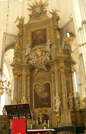 St. Mary's Church, Rostock - The gilded high altar depicts important biblical themes.