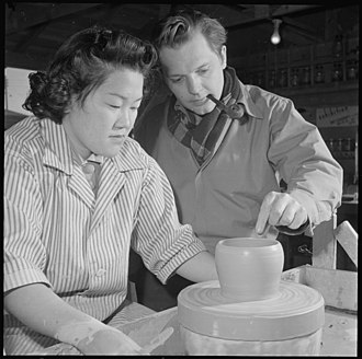 Daniel Rhodes - Daniel Rhodes (right) assists a ceramics student at Heart Mountain Relocation Center in Wyoming (January 1943)