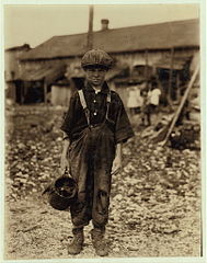 Henry, 10 year old oyster shucker who does five pots of oyster -sic- a day.jpg