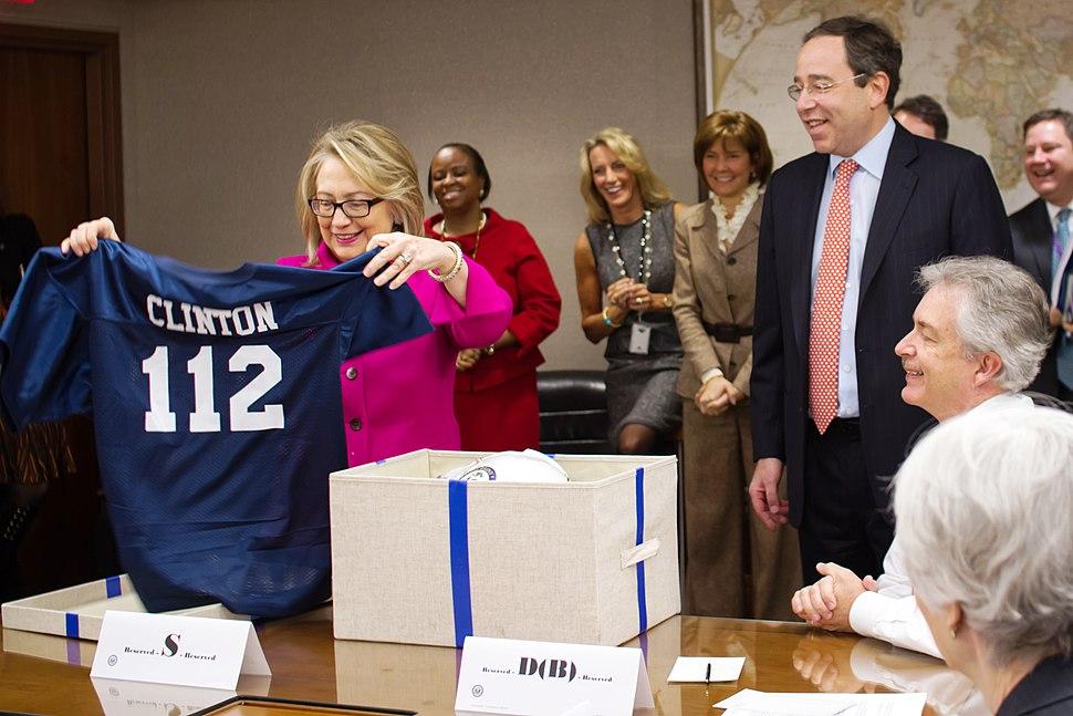 Hillary Clinton receives a football jersey