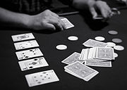 Texas hold 'em involves community cards available to all players (pictured here on the left).