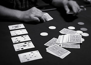 "Bluff (poker) - A game of Texas hold 'em in progress. ""Hold 'em"" is a popular form of poker."