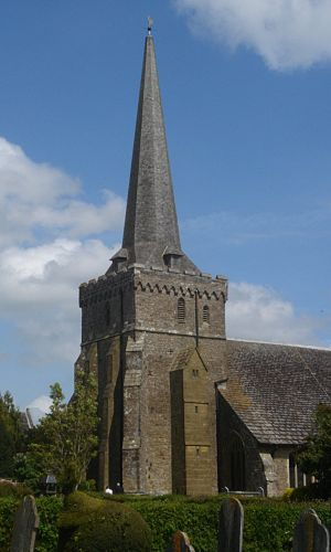 Holy Trinity Church, Cuckfield - The heavily buttressed tower and broach spire