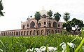 Humayun Tomb with natural flowers and grass.jpg