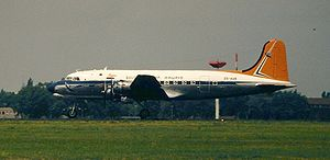 South African Airways - The Douglas DC-4 Skymaster was introduced in May 1946, on which SAA's first in-flight films were shown. This aircraft, registration ZS-AUB, is in Berlin (May 2000).