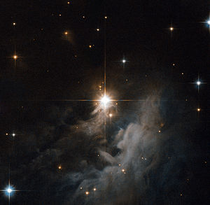 Interstellar cloud - Reflection nebula IRAS 10082-5647 observed by the Hubble Space Telescope.