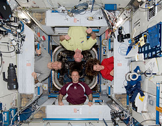 Harmony (ISS module) - Crew members hanging out of the USOS crew quarters
