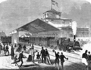 Aalborg station - A Xylography from 1869 showing the first train arriving at Aalborg Station on 18 September 1869.