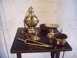 Thurible - Clockwise from upper left: Thurible, cup from inside thurible, incense boat, charcoal holder, and tongs (museum De Crypte, Gennep, Netherlands)