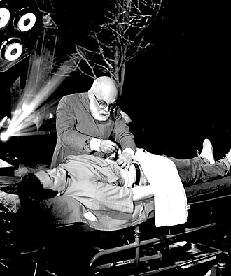 "Psychic surgery - James Randi using sleight of hand to duplicate ""psychic surgery"" on his Open Media series for ITV in 1991"
