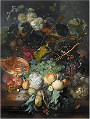 Still life of fruit upon a marble ledge, a bird's nest to the right and a basket of flowers above, insects throughout