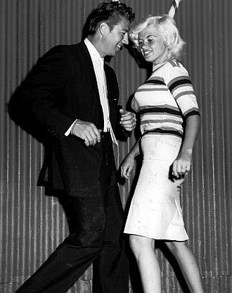 Mickey Hargitay - Hargitay and wife Jayne Mansfield doing the twist at the Candy Stik Lounge