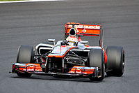 Jenson Exits the Hairpin (8093201928).jpg