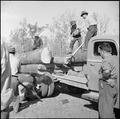 Jerome Relocation Center, Denson, Arkansas. Unloading cut timber at sawmill. Logs are hardwood oak . . . - NARA - 538821.tif