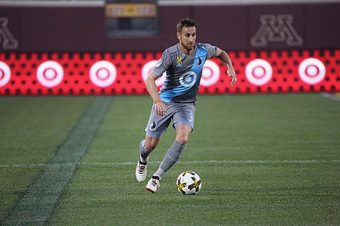 Minnesota United FC player with Target's logo on the jersey as well as on the stadium's advertisement boards. Jerome Theisson PHI vs MIN 2017-09-09 (36975333956).jpg