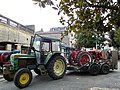 John Deere 2030 with IH tractor on trailer (1).jpg