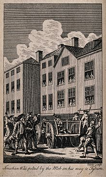 Jonathan Wild, the thief-taker, sitting on a cart, is pelted by the mob on his way to Tyburn.