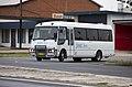 Junee Buses - Mitsubishi Fuso Rosa turning onto Edward Street.jpg