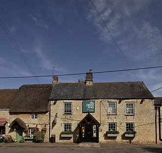 Kirtlington - The Oxford Arms public house (centre and right), with Garden Cottage next door (left)