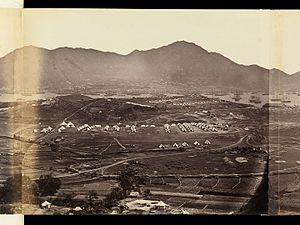 Kowloon Peninsula - Military encampments on Kowloon Peninsula in 1860, looking south toward Hong Kong Island.
