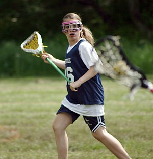 Women's lacrosse - A women's lacrosse player goes for a catch