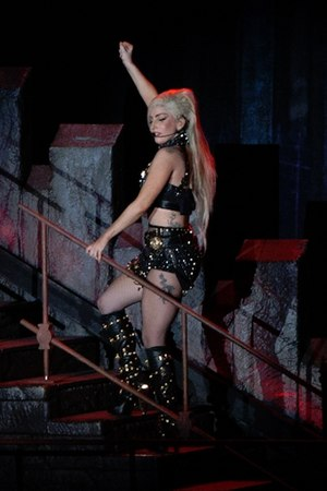 "Born This Way Ball - Lady Gaga performing ""The Edge of Glory"" in a Versace-designed cloth. Donatella Versace provided multiple outfits for the tour."
