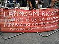 Latino America, placard in front of Ecuador embassy.jpg