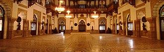 "Laxmi Vilas Palace, Vadodara - Darbar Hall featuring the ""Rajas Throne""."