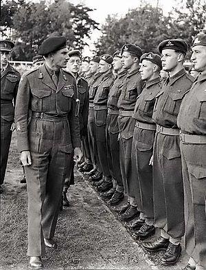 Battle of Verrières Ridge - Lieutenant-General Guy Simonds, the senior Canadian commander for the battle, during an inspection tour after VE-Day. PAC Photo