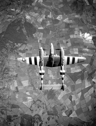 Aerial reconnaissance - A USAAF photo-reconnaissance Lockheed F-5 Lightning in flight over Europe circa June 1944. It is marked with invasion stripes to help Allied troops clearly identify it as an Allied plane.