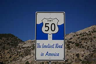 U.S. Route 50 in Nevada - Custom sign placed by the Department of Transportation to promote US 50 as The Loneliest Road in America.