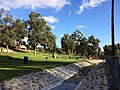 Looking South (Downstream) from wood bridge at Entrance- restrooms at top - Eucalyptus Trees throughout.jpg