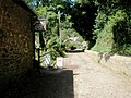 Looking past the Dunster Water Mill tea rooms towards Mill Gardens - geograph.org.uk - 925230.jpg