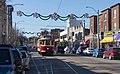 Loop Trolley car 001 eastbound on Delmar Blvd near Limit Ave, December 2018.jpg