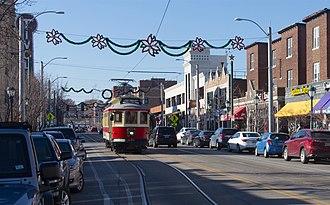 Delmar Loop - A Loop Trolley car in the Loop, on Delmar Blvd passing the Tivoli Theatre