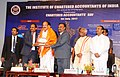 M. Venkaiah Naidu being presented a memento at the inauguration of the GST Nationwide programme, on the occasion of the Chartered Accountants' Day, in Hyderabad.jpg