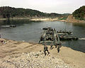 M2 Bradley Fighting Vehicles debark pontoon bridge.jpg