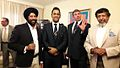 MS Dhoni with President FINACT Amardeep Singh and His Excellency Somasundaram Skandakumar.jpg