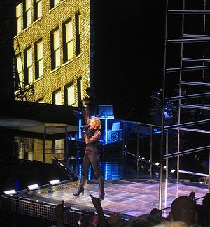 "Jump (Madonna song) - Madonna singing ""Jump"" while standing in front of a steel gymnastic equipment, on the Confessions Tour."