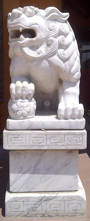 Sanggar Agung - Left side Chinese lion statue represent Yang force, male, positive, bring, carry a ball.