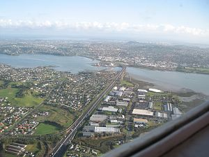 Mangere Bridge (bridges) - The duplicated Mangere Bridge seen from the south, with the suburb of the same name to the left.