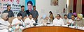 Manish Tewari presiding over the meeting of the District Vigilance & Monitoring Committee, at Ludhiana, Punjab. The Member of Parliament and Co-Chairman of the Committee, Shri Sukhdev Singh Libra is also seen.jpg