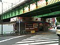 Manseibashi Overpass (Chūō-Sōbu Line) viewed west from south, near Manseibashi Station - Mansei Cutlet Sandwiches stand at Radio Garden, Akihabara - 2010-05-04.jpg
